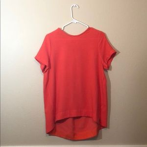 Orange high low blouse